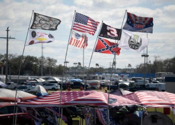 Mandatory Credit: Photo by Phelan M Ebenhack/AP/Shutterstock (10552425ct) Flags fly in the infield of Turn 4 during NASCAR Daytona 500 auto race qualifying at Daytona International Speedway in Daytona Beach, Fla NASCAR Daytona 500 Auto Racing, Daytona Beach, USA - 09 Feb 2020