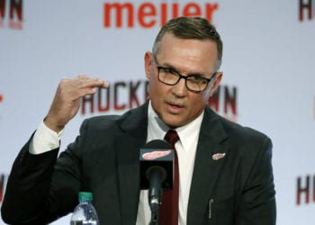 FILE - In this April 19, 2019, file photo, Steve Yzerman answers a question during an NHL hockey news conference where he was introduced as the new executive vice president and general manager of the Detroit Red Wings, in Detroit. The Detroit Red Wings desperately hope to win the NHL draft lottery, giving them the first shot to perhaps select Canadian winger Alexis Lafreniere. (AP Photo/Carlos Osorio, File)