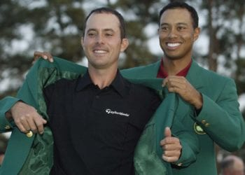 AUGUSTA, GA - APRIL 13:  Mike Weir of Canada is presented with the green jacket by Tiger Woods of the USA  after winning the play off after the final round of the 2003 Masters Tournament at the Augusta National Golf Club in Augusta, Georgia on April 13, 2003. (Photo by Andrew Redington/Getty Images)