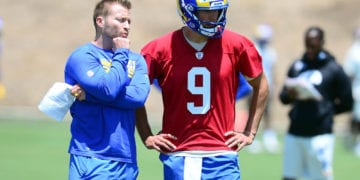 May 27, 2021; Thousand Oaks, CA, USA; Los Angeles Rams head coach Sean McVay speaks with quarterback Matthew Stafford (9) during oraganized team activities.  Mandatory Credit: Gary A. Vasquez-USA TODAY Sports