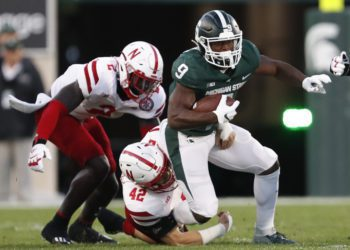 Sep 25, 2021; East Lansing, Michigan, USA; Michigan State Spartans running back Kenneth Walker III (9) gets tackled by Nebraska Cornhuskers linebacker Nick Henrich (42) during the first quarter at Spartan Stadium. Mandatory Credit: Raj Mehta-USA TODAY Sports